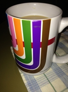 "My new favorite cup. I bought it earlier this very same day. It's colored with the train lines of the ""L"". Is the universe trying to tell me something?"