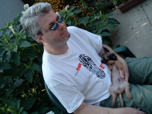 Sitting in our back yard after the AIDS walk in 2007 with my friend Mark's then-puppy Rocco.